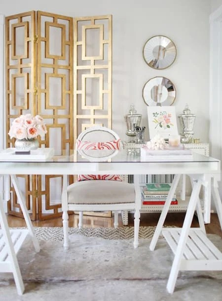 Consistently using mixed metals throughout your room, like the gold in this office