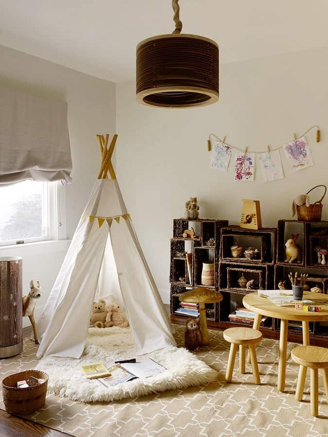 Kids' playroom with a table and chairs and tee-pee