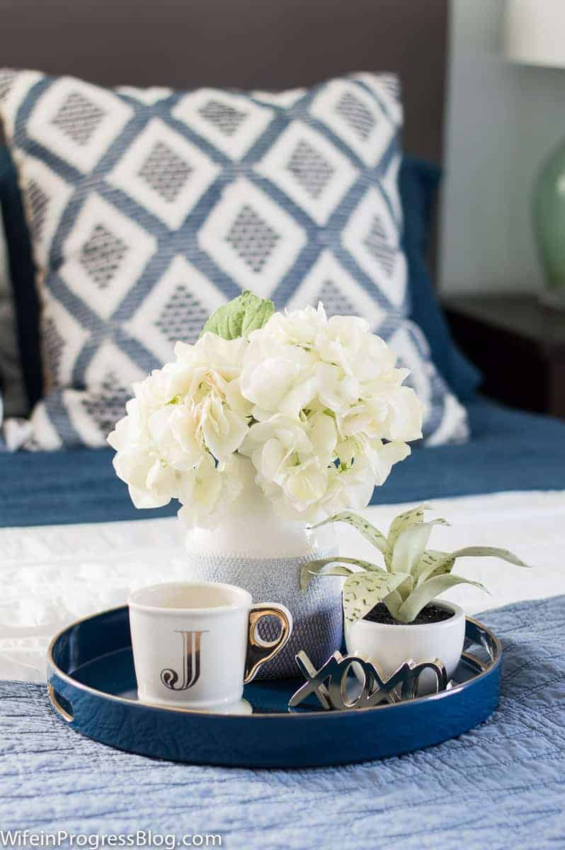 This serving tray is decorated with monogrammed mugs and flowers. It's an affordable way to add a personal touch to this winter bedroom