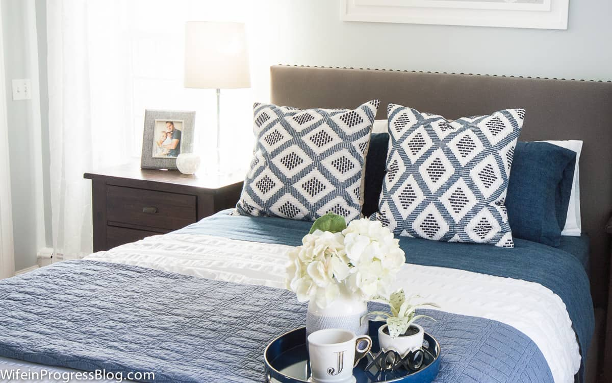 Cozy flannel blankets give this winter bedroom decor a warm touch in the winter