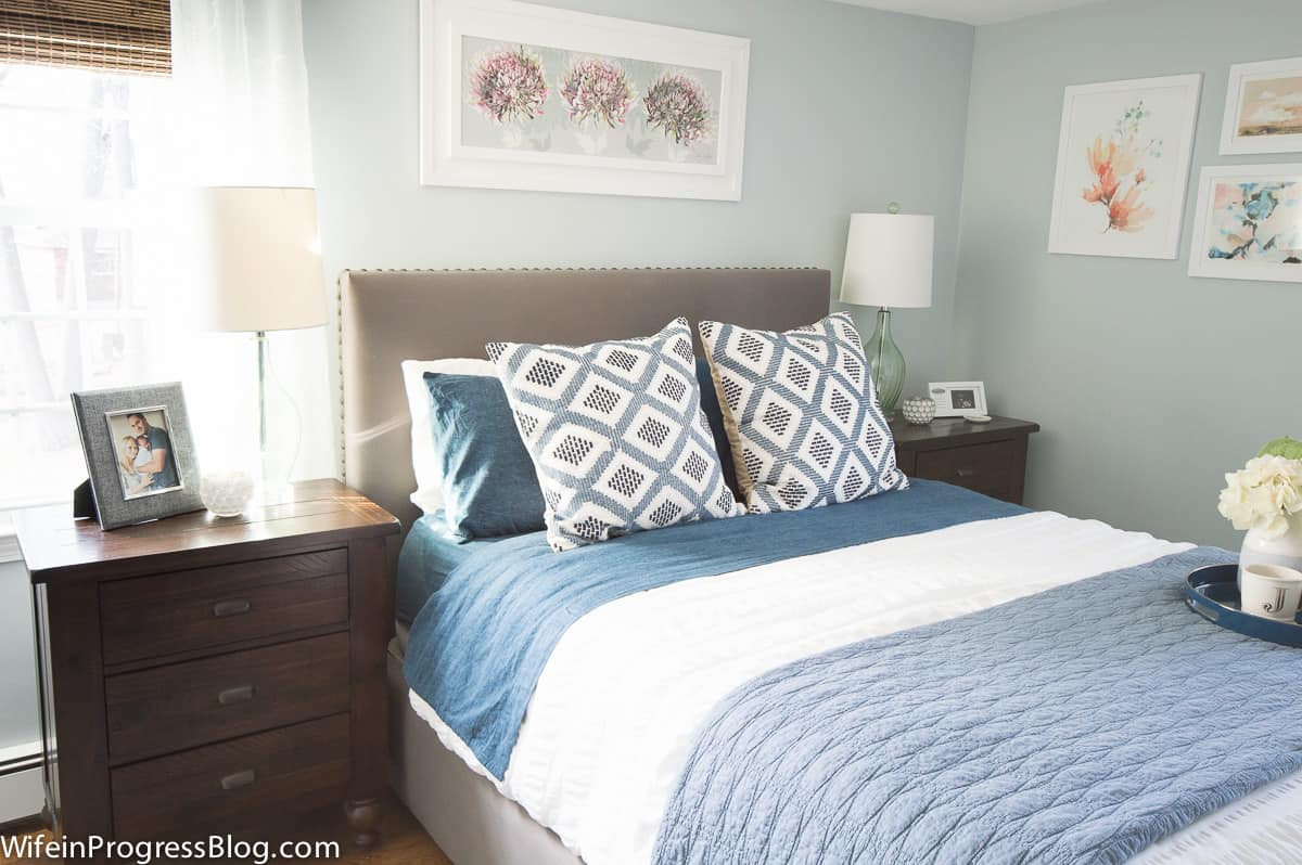 This cozy winter bedroom decor uses warm shades of blue and comfy patterns to give this bedroom a winter refresh