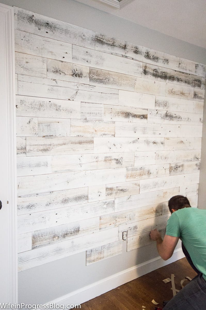 Baby's nursery with reclaimed wood accent wall