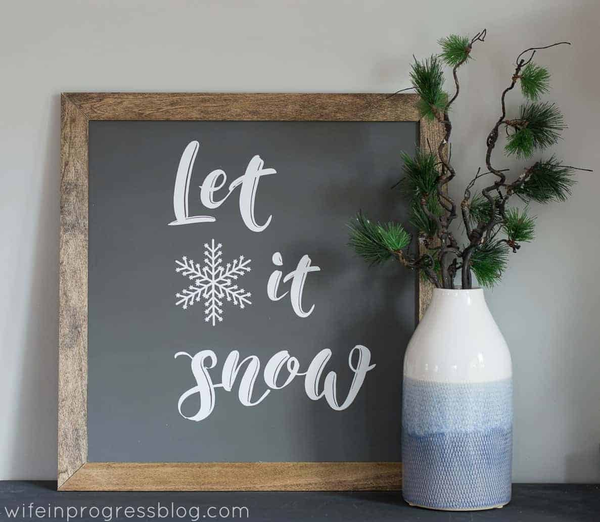 This Let it Snow farmhouse style sign is simple DIY Christmas decor that you can use for years to come!
