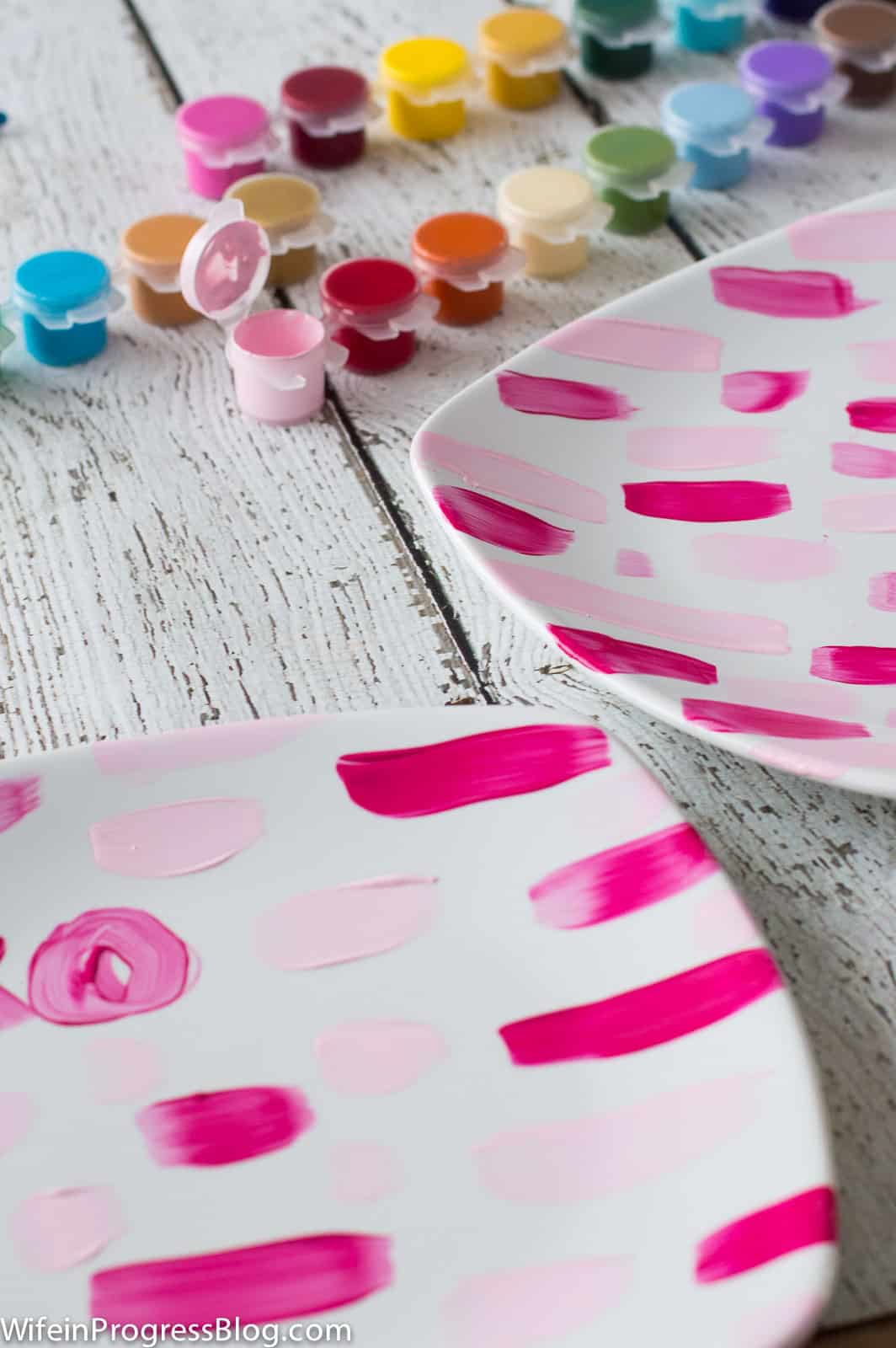 For this painted Valentine's plate project, I used enamel paint in various shades of pink