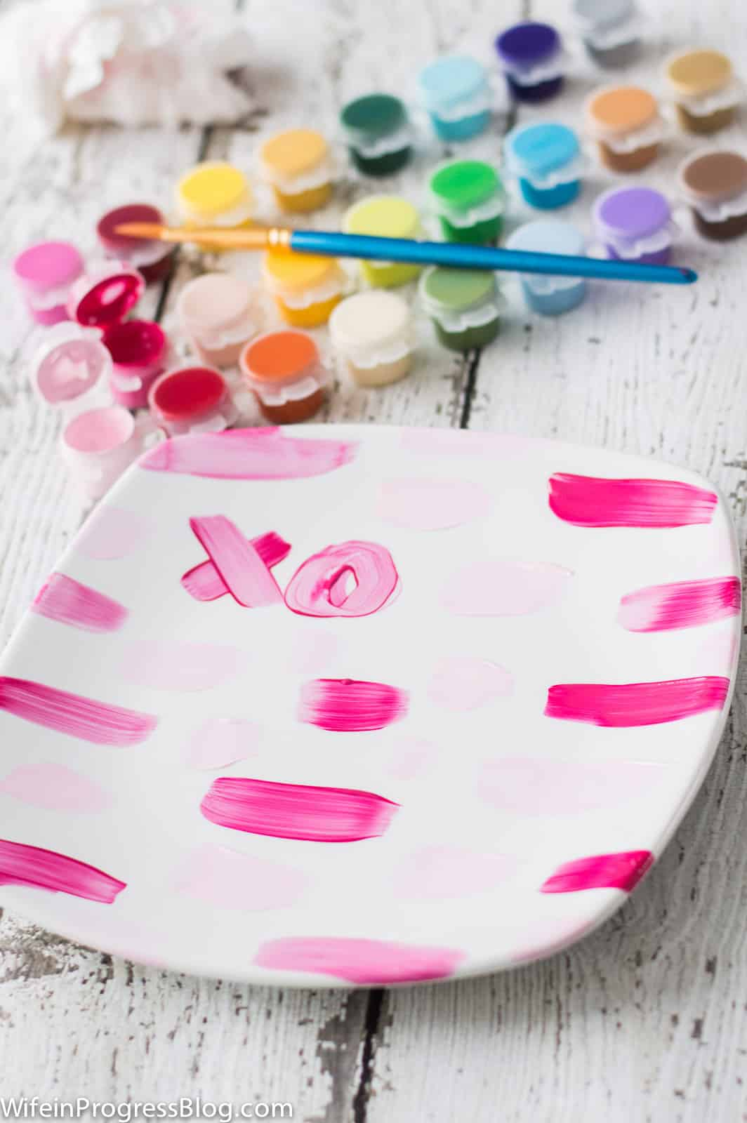 These DIY painted Valentine's Day plates are a quick and easy project that anyone can do