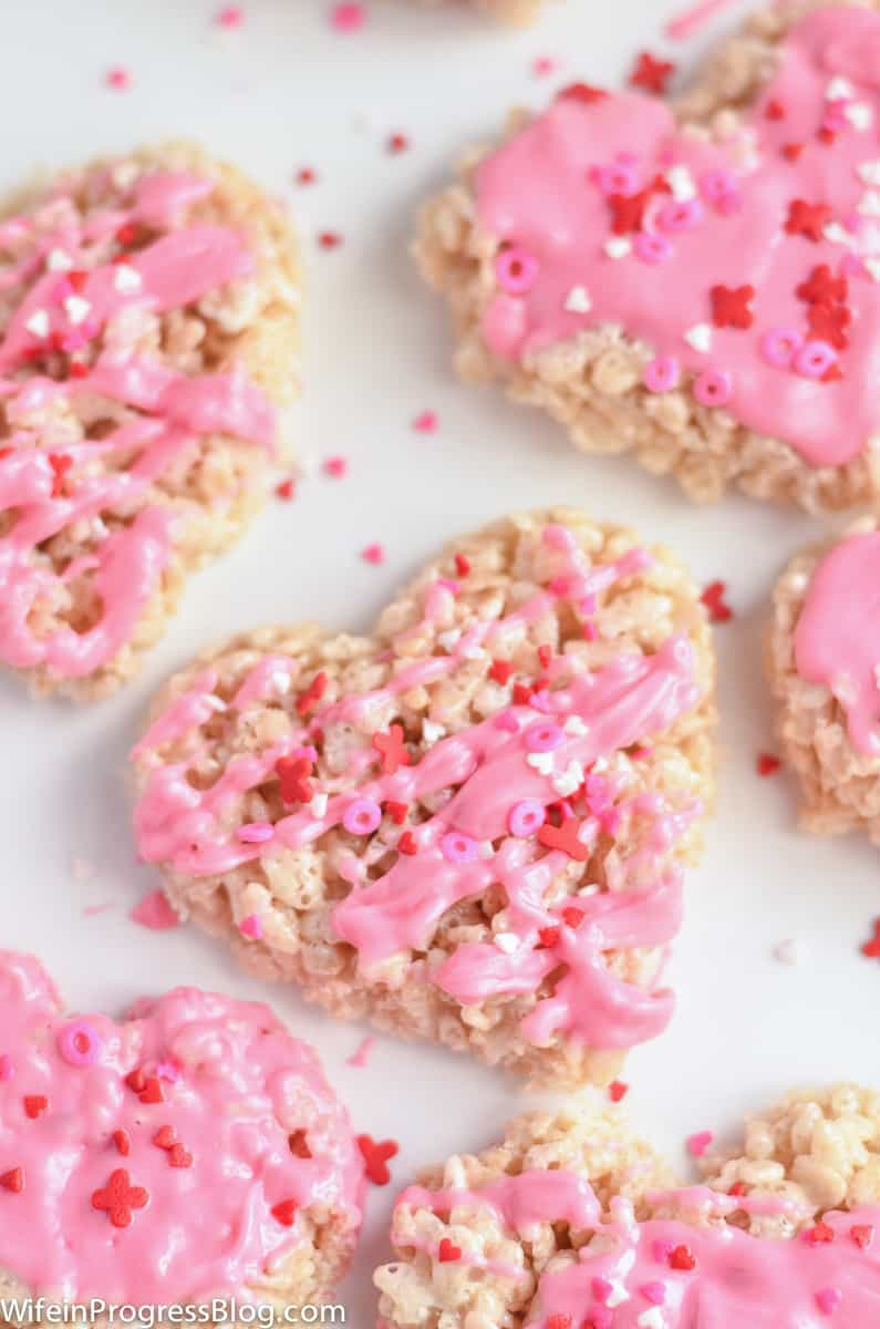 Hearts drizzled with pink candy melts and Valentine's sprinkles