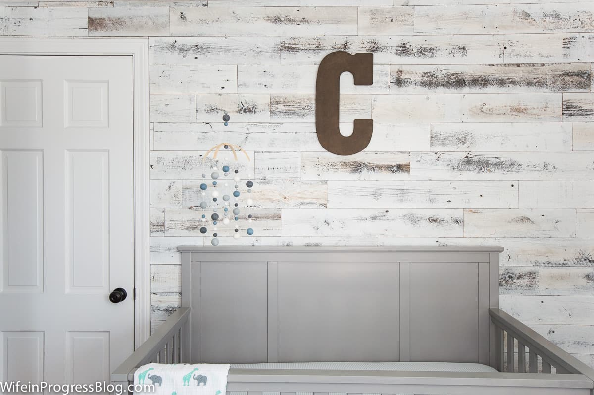 planked walls add charm and interest to a cookie cutter room