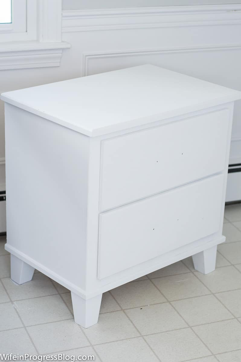 The nightstand, now painted white, before drawer handles are reattached