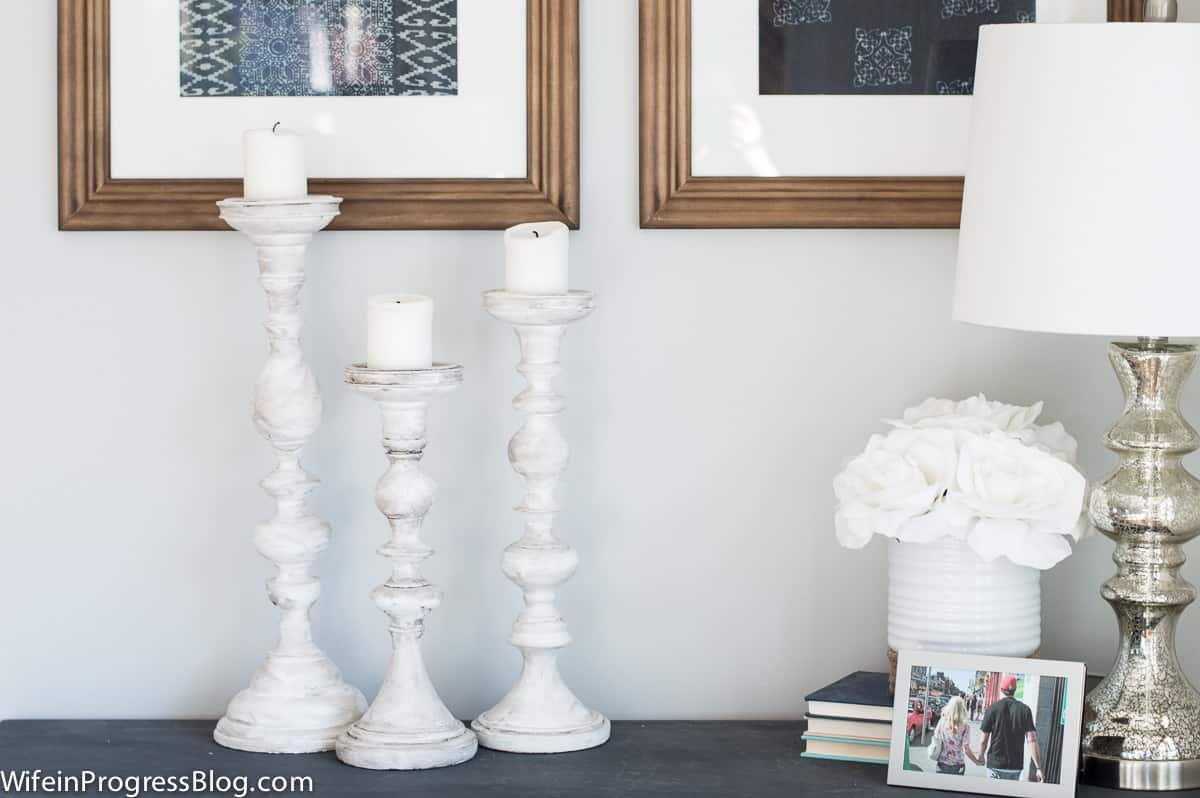 With a few simple coats of DIY white chalk paint, these candlesticks look like vintage finds!