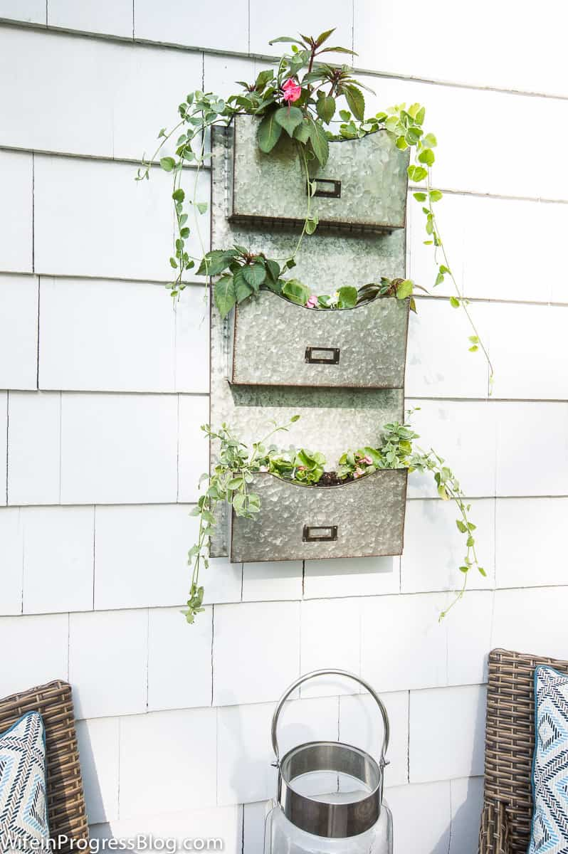 a unique farmhouse style planter from a galvanized mail holder