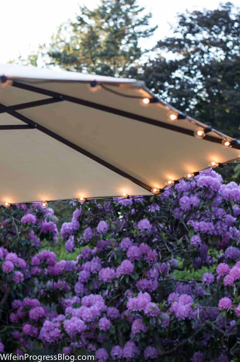 Add inexpensive string lights to an umbrella for instant ambience