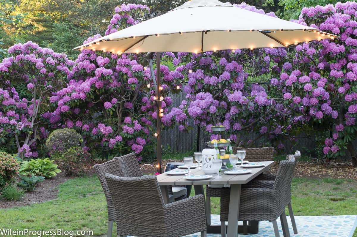 Add inexpensive string lights to an umbrella for instant ambience   patio decor