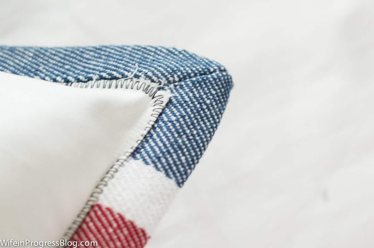 White fabric stitched the inside border of patriotic placemat