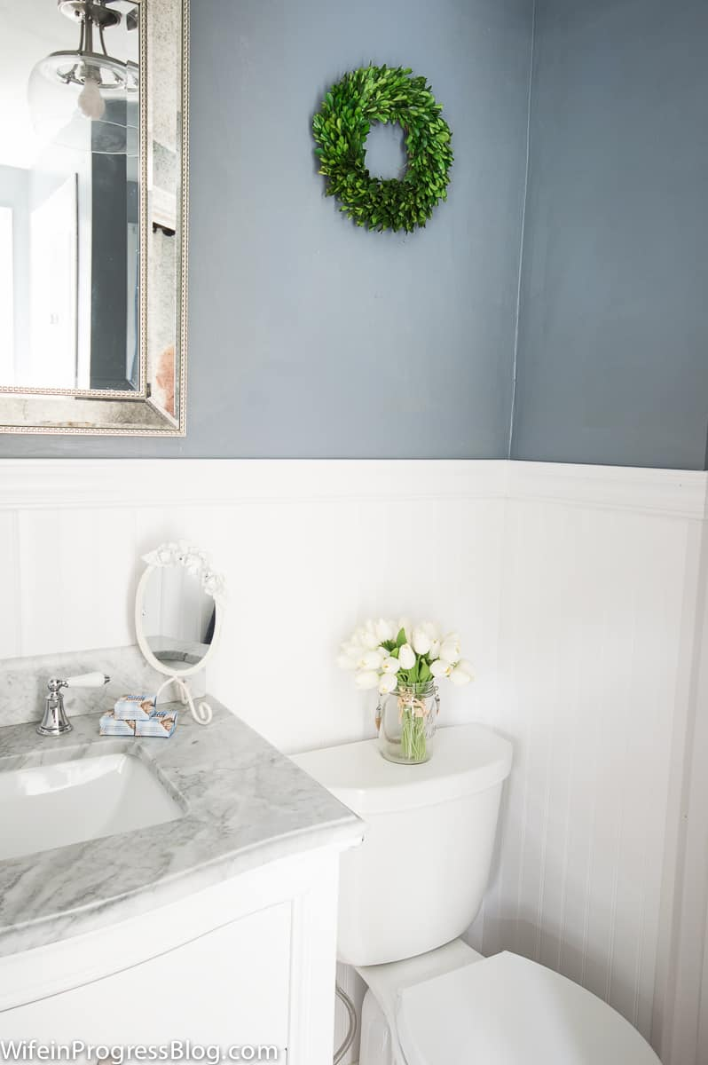 Sherwin Williams Serious Gray bathroom walls with white wainscoting and marble topped vanity