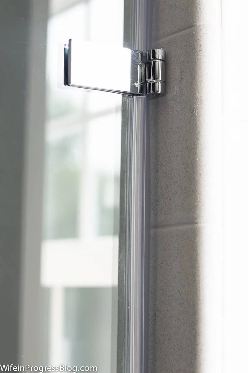 The heavy-duty anchor hinges for this single pane glass shower door are chrome finish to match our other master bathroom fixtures
