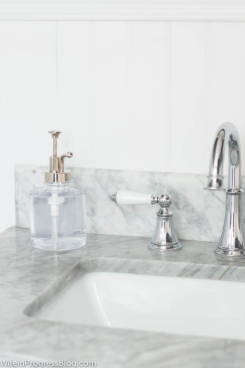 I love this grey and white marble vanity top because it lightens up the room with a sleek look