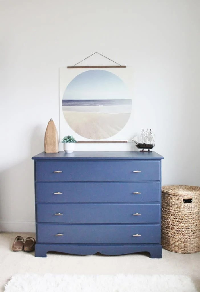 A dresser painted with Naval by Sherwin Williams. Such a pretty shade of blue!