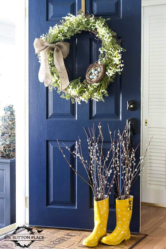 Front door with wreath painted in the color Naval by Sherwin Williams