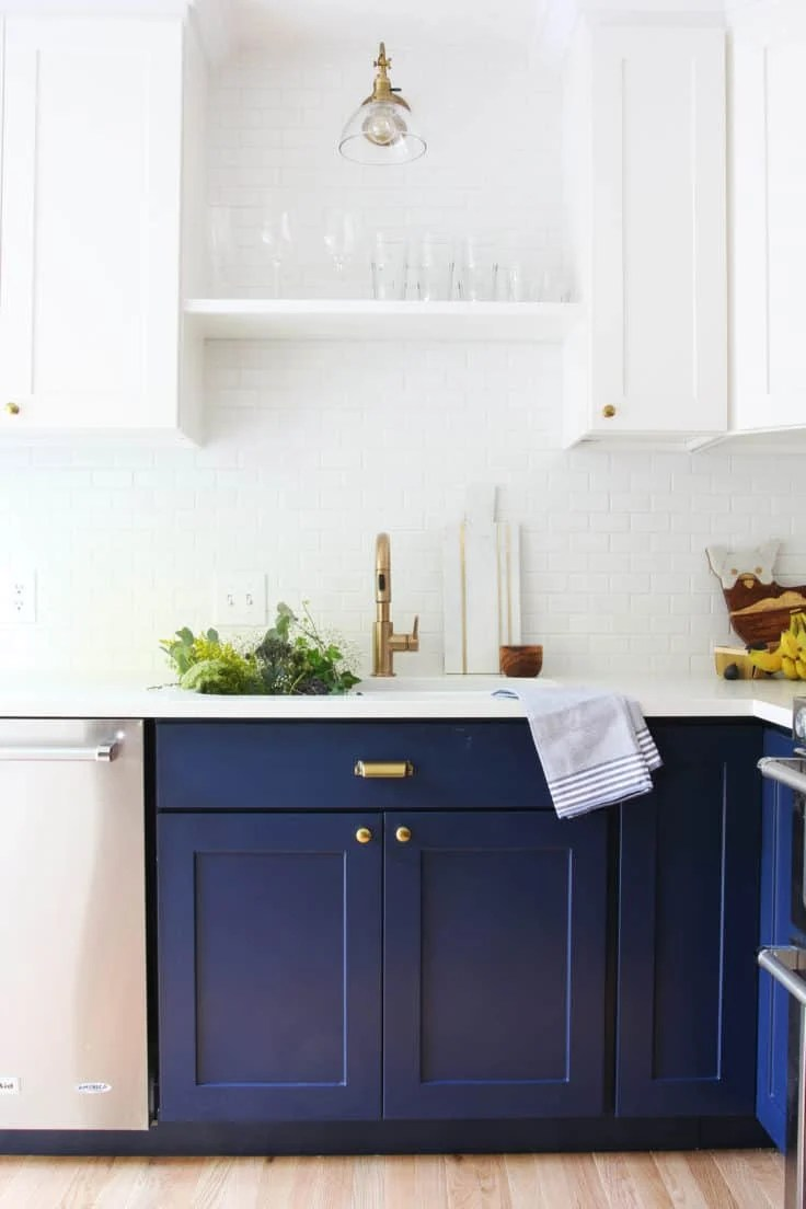 Two toned kitchen cabinets with white uppers and Naval base cabinets