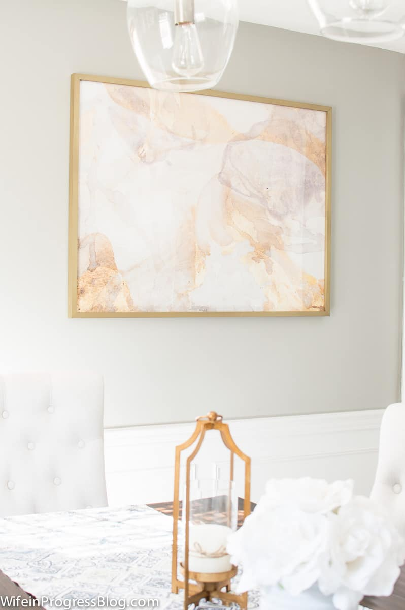 A beautiful neutral dining room makeover with gold accents