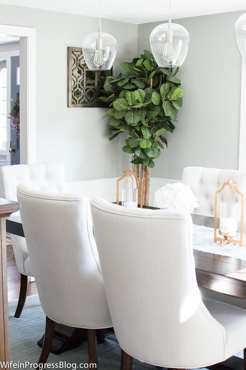 Neutral dining room with gold accents