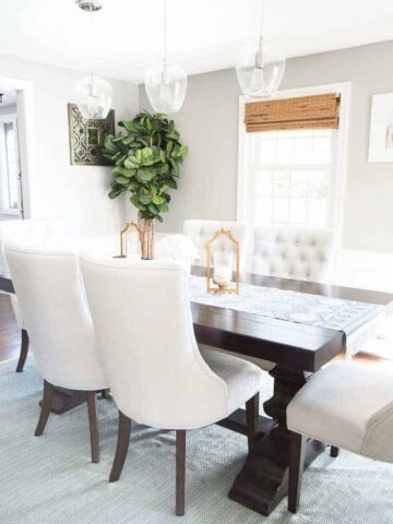 A neutral dining room with pops of gold and pink. So elegant!