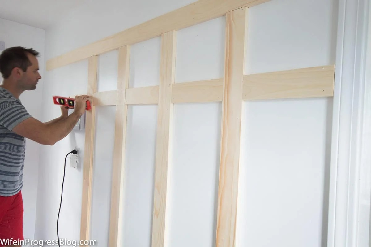 Using a brad nail gun is the quickest way to install board and batten but a regular hammer and nails works too