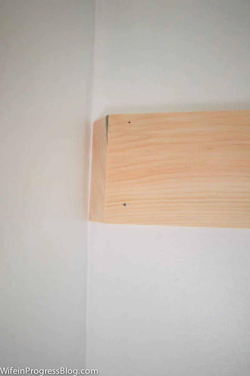 A mitered edge to join the corners of the board and batten