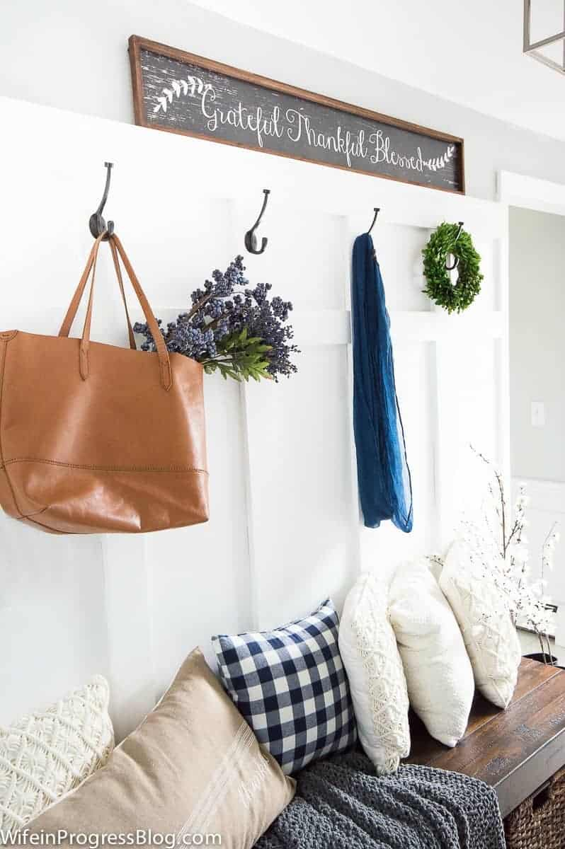 Add a board and batten treatment to the wall of an entryway