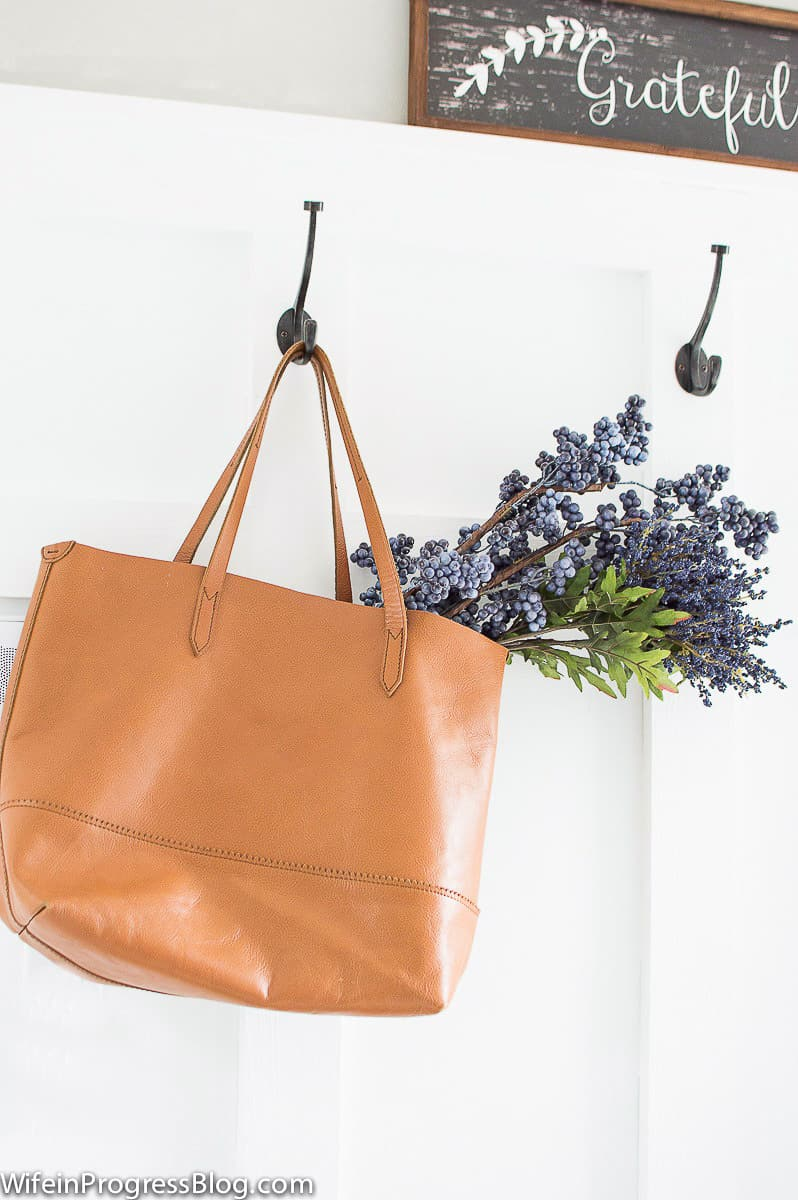 Add flowers to a bag for simple mudroom decor