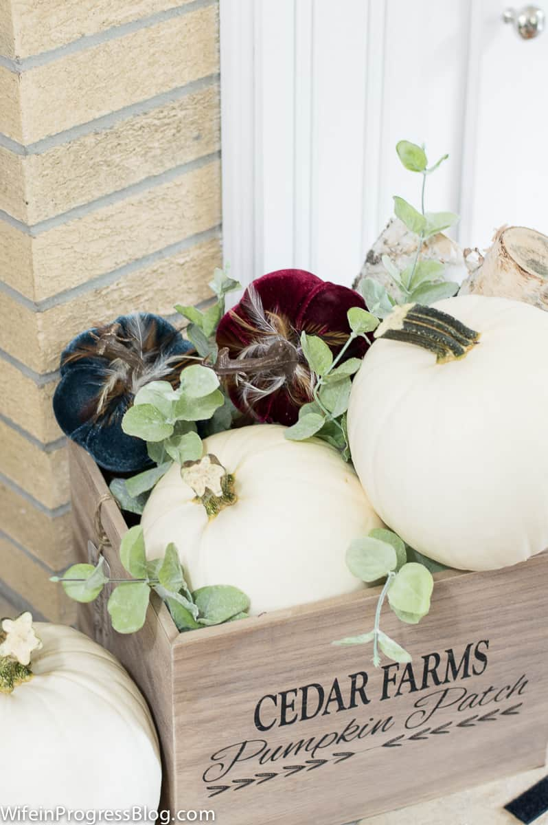Mostly Mauve Fall Home Tour - add pumpkins to a crate