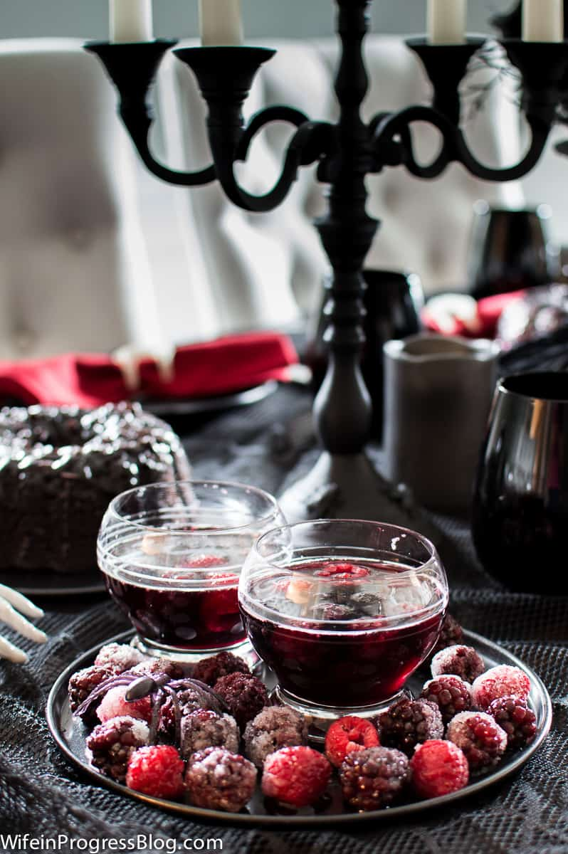 Blackberry sangria looks delicious as part of this gothic Halloween tablesetting!