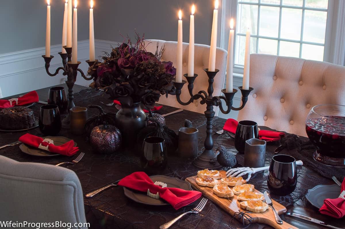 An elegant gothic Halloween table setting. I love those iron candelabras!