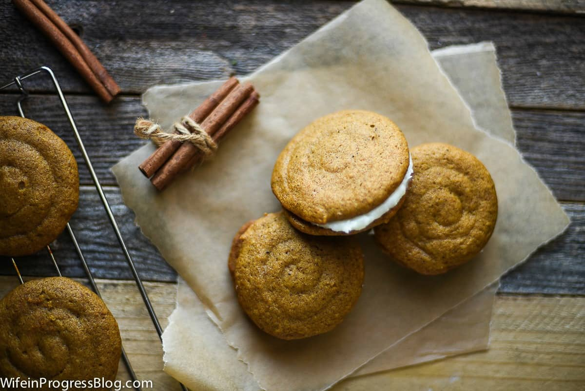 Three pumpkin whoopie pies with cream cheese filling