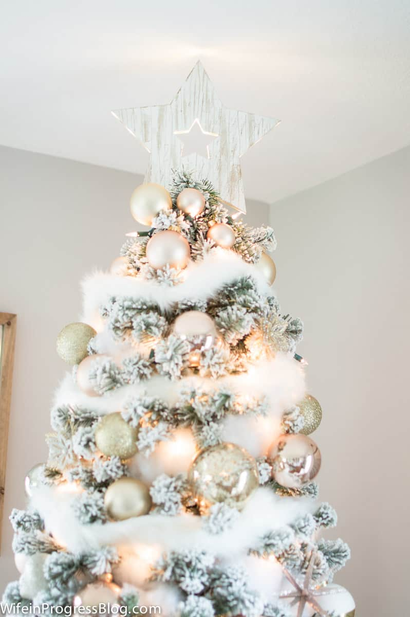 Use polyster pillow stuffing to add a soft faux snow trim effect on a Christmas tree