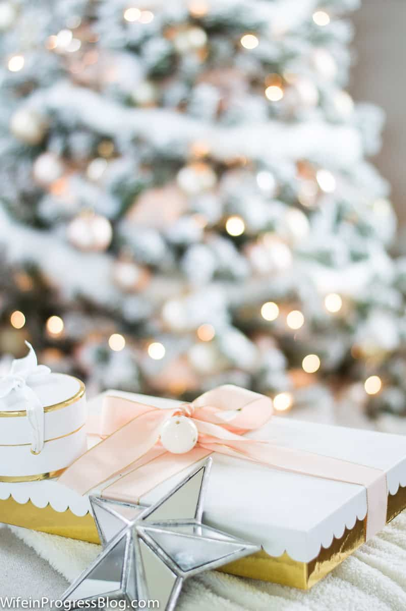 Use beautiful blush pink ribbon and a mini ornament to decorate Christmas gifts