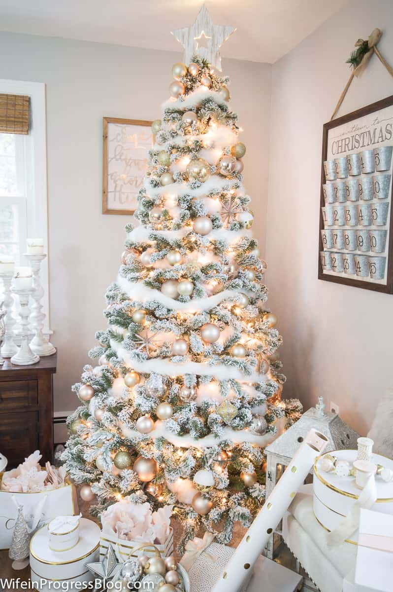Flocked Christmas tree with white and rose gold ornaments