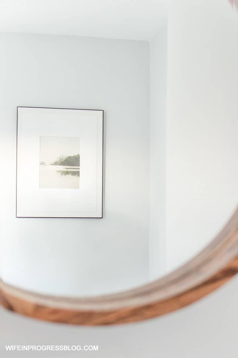 simple bathroom artwork creates a clean and modern look
