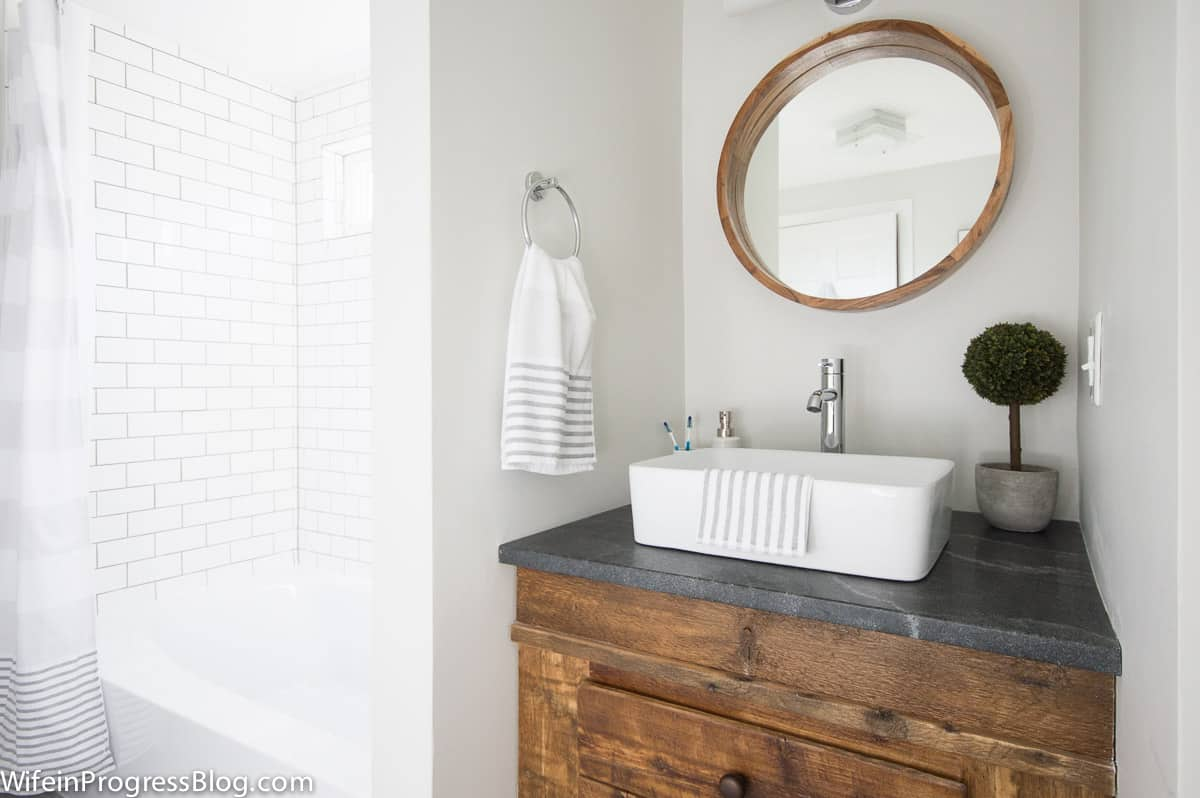 modern farmhouse style bathroom with rustic wood and walls painted Benjamin Moore Paper White