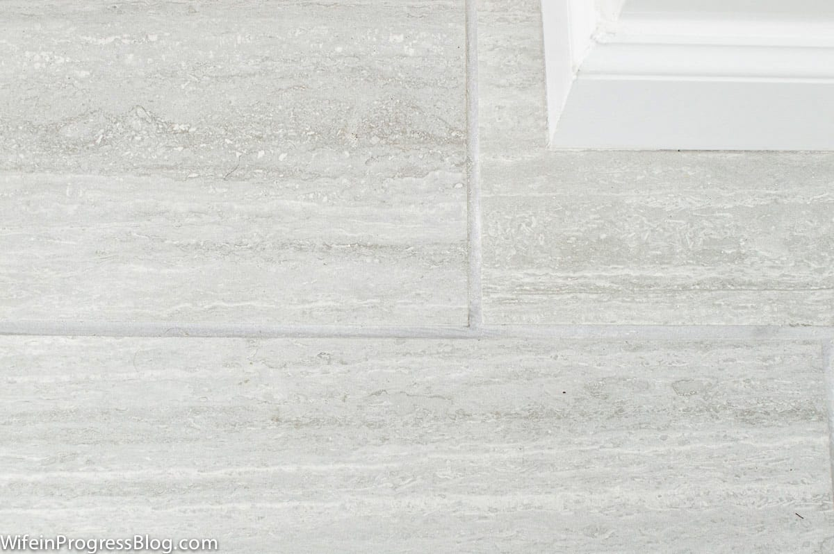 Close-up of simple gray tile in a farmhouse style bathroom