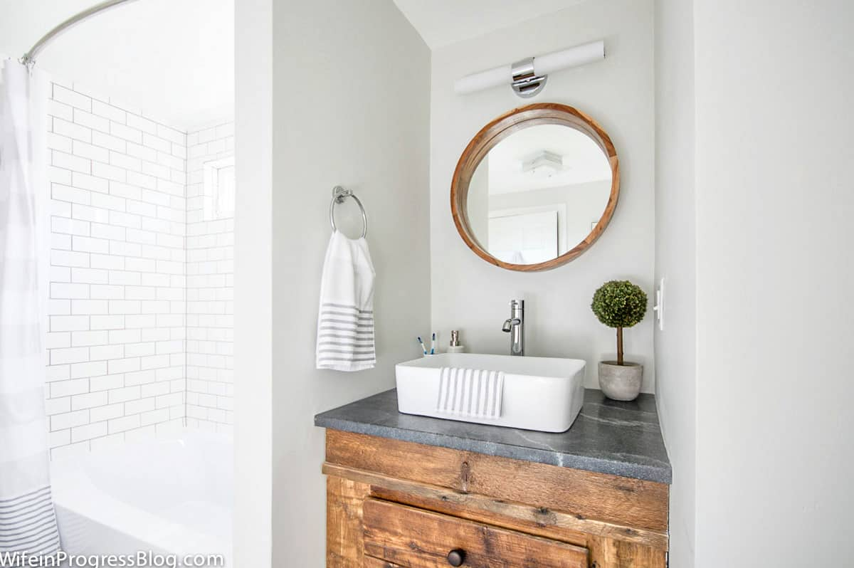 This modern farmhouse bathroom is painted a light gray color - Paper White by BM and it's perfectly light with no undertones