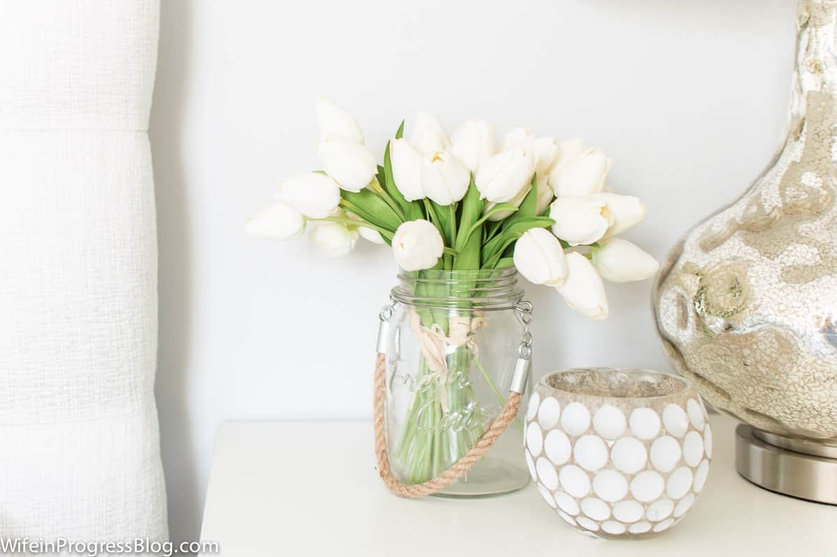 Stonington Gray in a bright bedroom with lots of natural light and fresh flowers on the nightstand