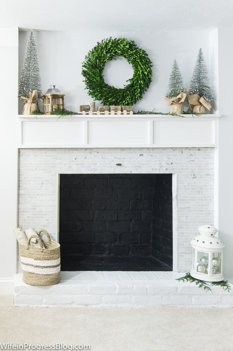 Christmas Decorating Ideas For The Home - add a boxwood wreath and some natural elements to create a farmhouse style Christmas mantel
