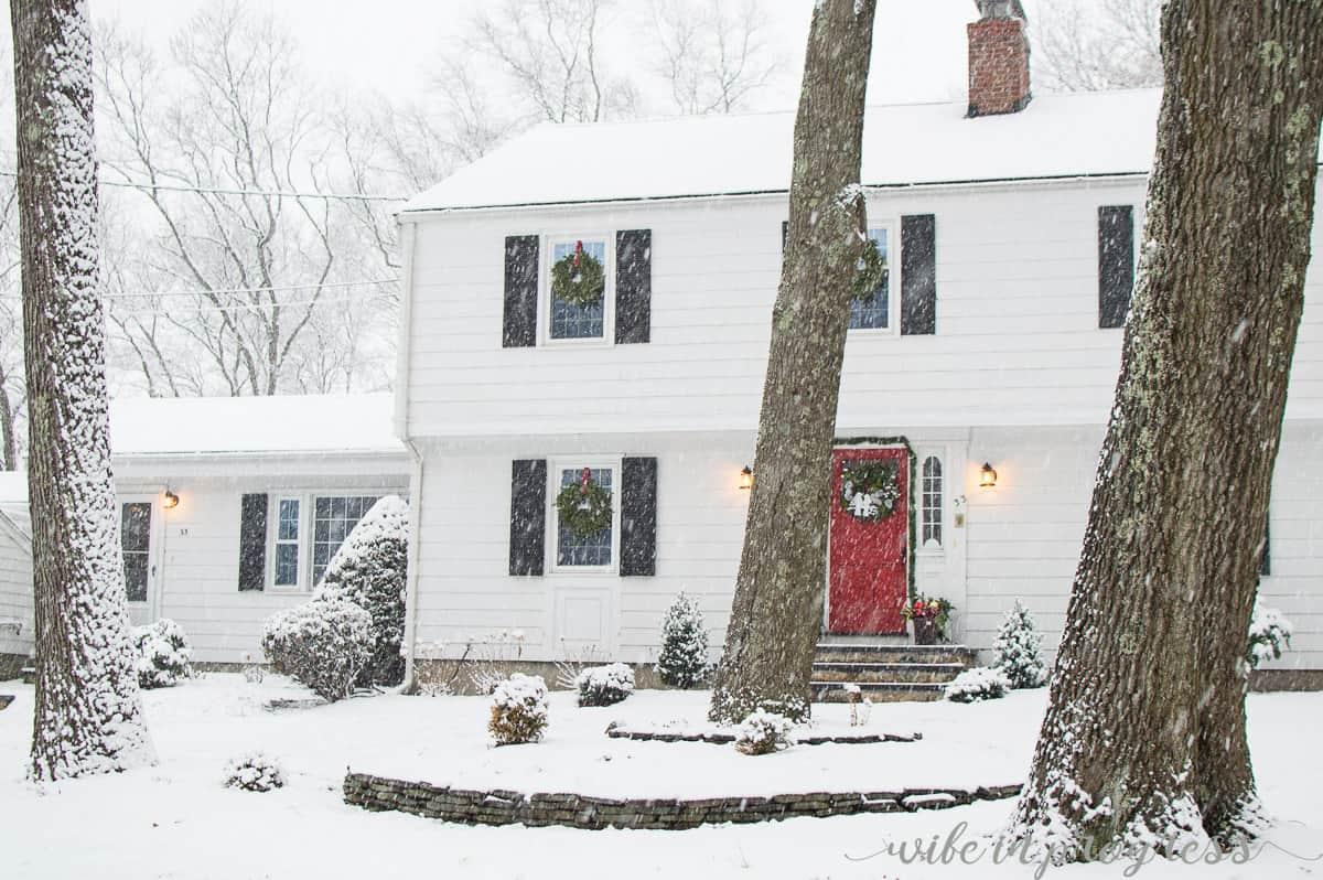 Traditional colonial house painted white with red front door. So Christmassy!