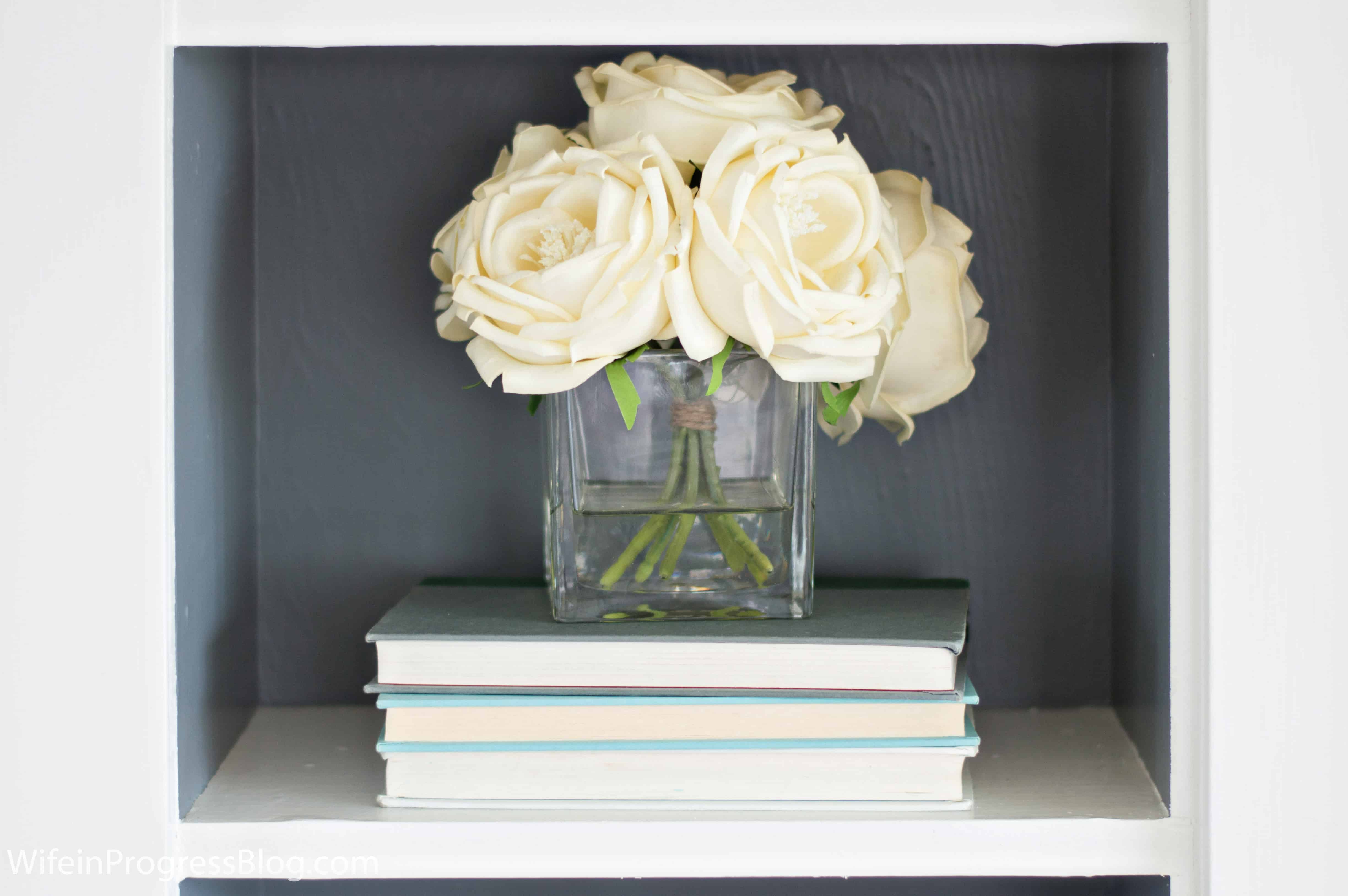Are you adding height to your coffee table or bookshelf styling? If you're not, this might be one of the reasons your efforts never look quite right!