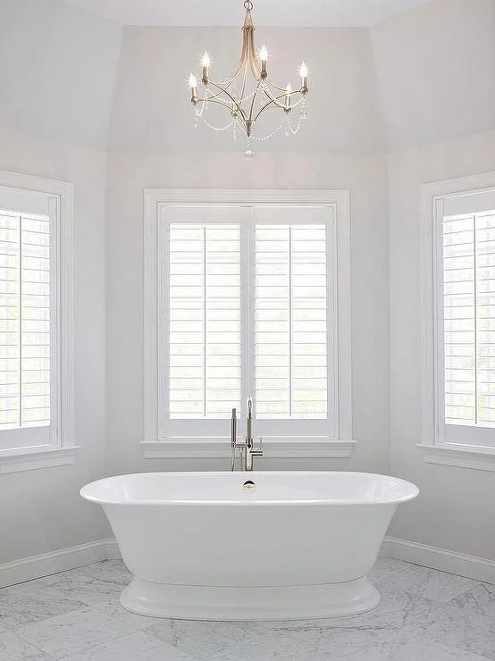 An elegant bathroom painted with Paper White by Benjamin Moore