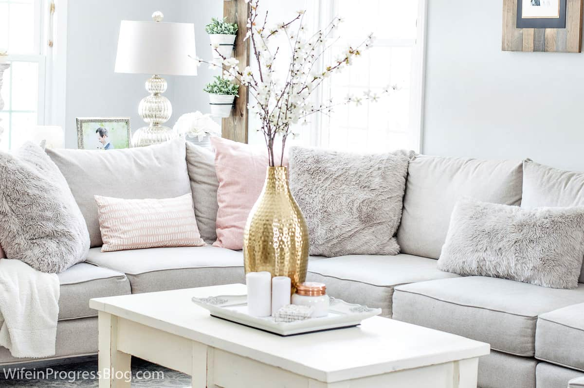Keeping your decor minimal with more muted colors is a great way to create a cozy feeling in your living room this winter