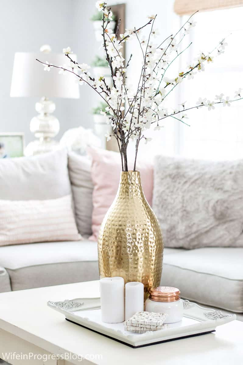 Flowers, plants and tree clippings add a natural touch to winter living room decor