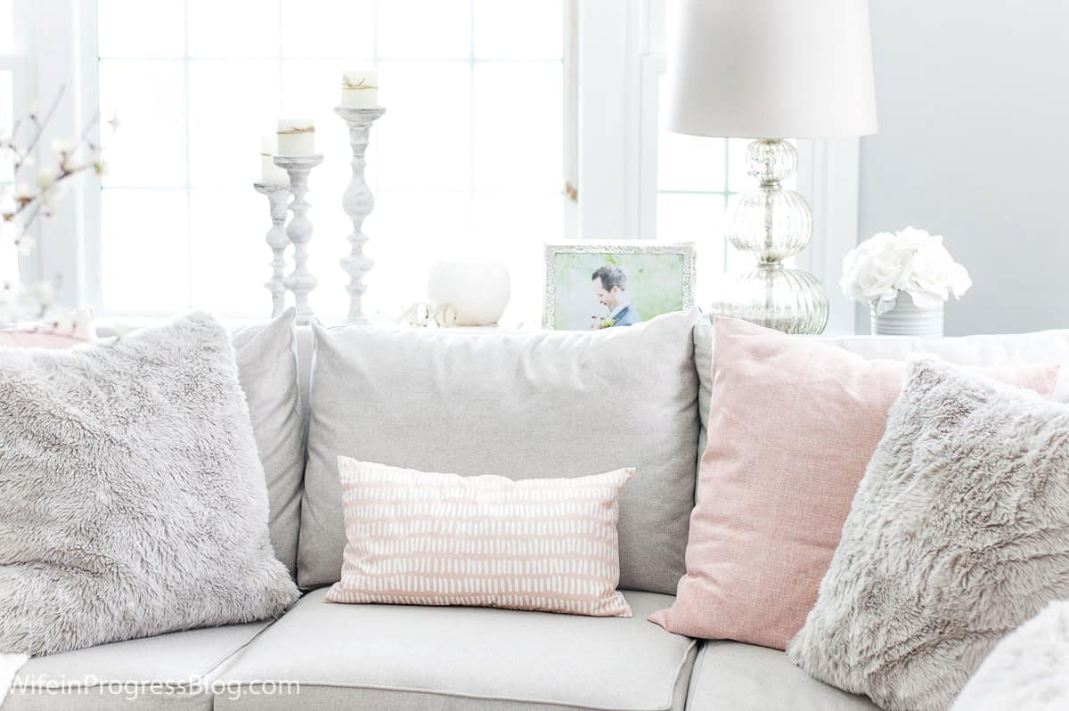 Choosing soft muted tones will add a sense of warmth and coziness to your winter living room decor