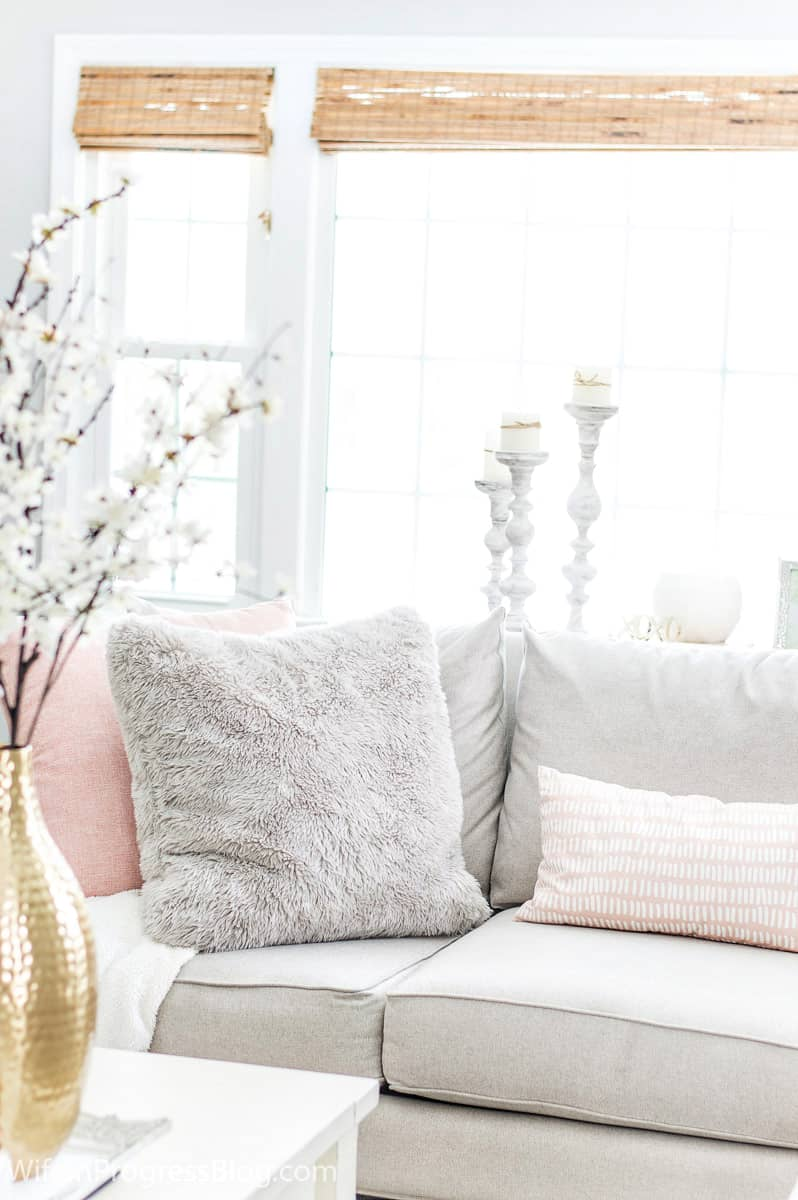 Don't be afraid of textures you might not normally gravitate to! Faux fur can add so much coziness to your winter living room decor! Just look how comfy and warm these pillows look!